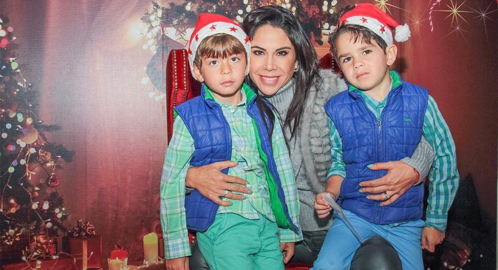 Paola Rojas y sus hijos